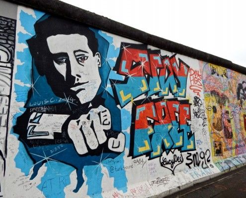 An example of an artistic political warning from the East Side Gallery