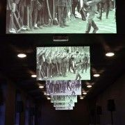 The room in which the exhibition portrays the racism against Jews. Image of supporters hailing Hitler.