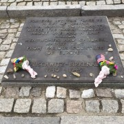 """English inscription of the international monument located between the ruins of the gas chambers and crematorium 3 and 4 in Birkenau that reads """"For ever let this place be a cry of despair where the Nazis murdered about one and a h"""