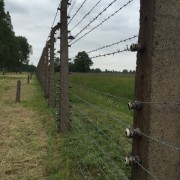 A look inside Birkenau from the outside of the barbed wire electric fence.