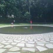Full shot of the pond in the memorial to the Roma and Sinti