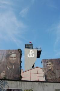 "At the Muzeum Powstania Warszawskiego - Warsaw Rising Museum with the ""Kotwica"" symbol of the Polish Underground."