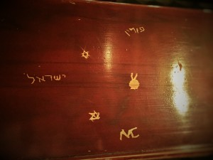 Graffiti in a pew in a progressive synagogue in Krakow