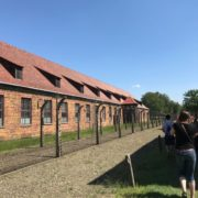 Electric fences, guard tower, and dorms at Auschwitz
