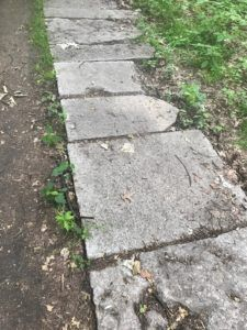 1. This photo depicts a pathway constructed of Grave Stones where a cemetery was located before it's destruction.