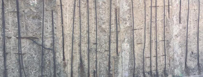 The cracks within the Berlin Wall.
