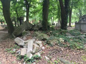 Field 6: Piles of broken headstones that are out of place