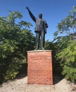 A monument to Lenin. The statue towers over the average person, so any passersby always has to gaze up at his glory.