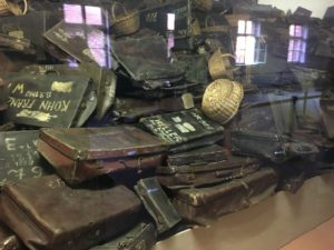 Suitcases taken from Auschwitz prisoners upon their arrivals preserved in Auschwitz exhibition.