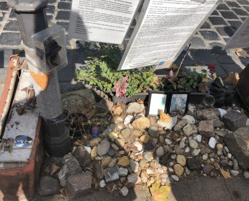 Mementos and pictures of Hungarian Jewish holocaust victims brought by citizens which are a part of the counter memorial.