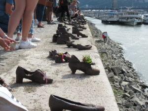 The Shoes on The Danube memorial in Budapest, marks a spot where thousands of Jews were shot into the Danube river.  This site is perhaps controversial for lacking descriptors, but it forces people to think about what had happened.