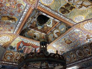 The replication of the ceiling of Gwoździec, a wooden synagogue in pre-war Poland. The exterior roof of the synagogue emerges from the first floor of the museum inside a glass casing.