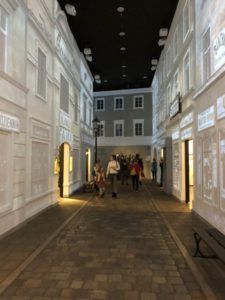 """A replication of a typical Jewish Street from the gallery """"On the Jewish Street (1914-1939)"""". Visitors can veer off into rooms along the street to learn about important contributions to Jewish culture during this time."""