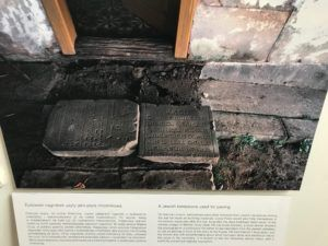 Photo at the Galicia Jewish Museum of a Jewish Gravestone that had been used for Paving