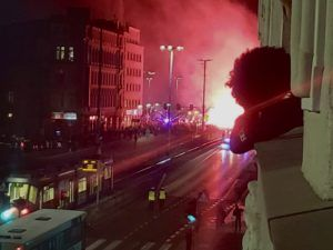 My afro against the red flares of the Polish nationalist parade on the Polish Independence Day.