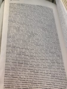 "A page from the ""Book of Names"" in Block 27, currently recording 4.2 million names, birth dates, home towns, and places of death of Holocaust victims."