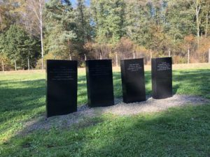 One set of various tombstones around Auschwitz, showing respects to the victims who died, and as a result remembering them as people and not a number.