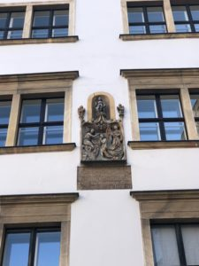 A plaque in Judenplatz from the Middle Ages celebrates the burning of the old synagogue and murder of Vienna's first Jewish community, declaring the city 'baptized' or cleansed of Judaism