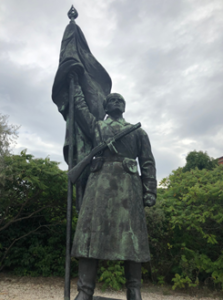 This is a communist statue that can now be found in Momento Park in Hungary which is home to all of the other statues from that era. They have been removed from the cities and placed into a monument park for historical reference