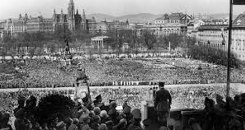 This is a photo of Hitler giving a speech in Vienna at the Imperial Palace. His trip was contested by Austrian citizens but when he arrived and gave his speech he was greeted with his warmest welcome in any other country Germany had annexed