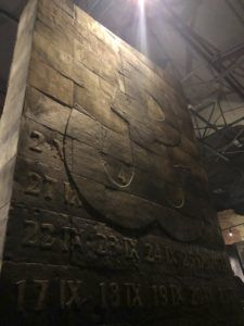 A ceaseless heartbeat pounds from central column in the Warsaw Rising museum, bearing the symbol of the Polish resistance